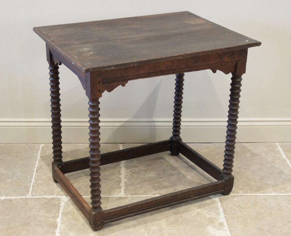 A 17th century and later oak side table, the rectangular cleated twin plank top raised upon bobbin