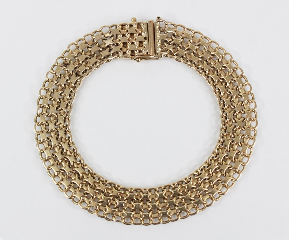 A gold coloured woven-link bracelet, with tongue and box snap clasp fastening, stamped '18K' and '