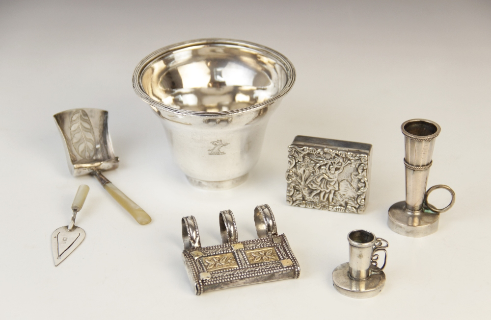 A 19th century silver coloured wine strainer, of tapered form with reeded border, armorial crest