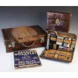A crocodile skin attaché case, early 20th century, 46cm wide, a writing case and vanity case,