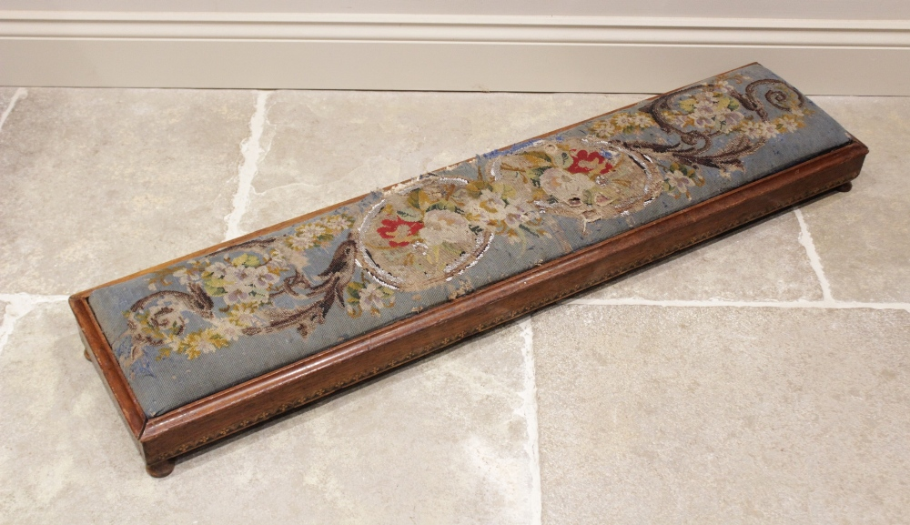 A Victorian Berlin work kneeling prayer stool, the foliate pattern pad within a gently angled