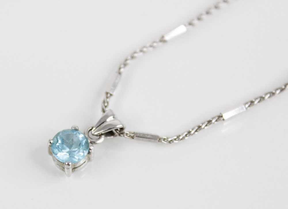 A blue topaz pendant on 18ct gold chain, the central round mixed cut blue topaz (measuring 6mm - Image 2 of 3