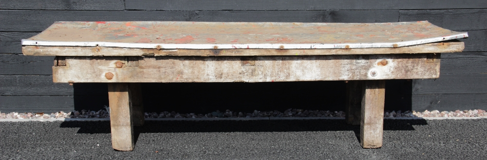 A 19th century slab top bench, cheese-turning bench, the later galvanised metal cover over the