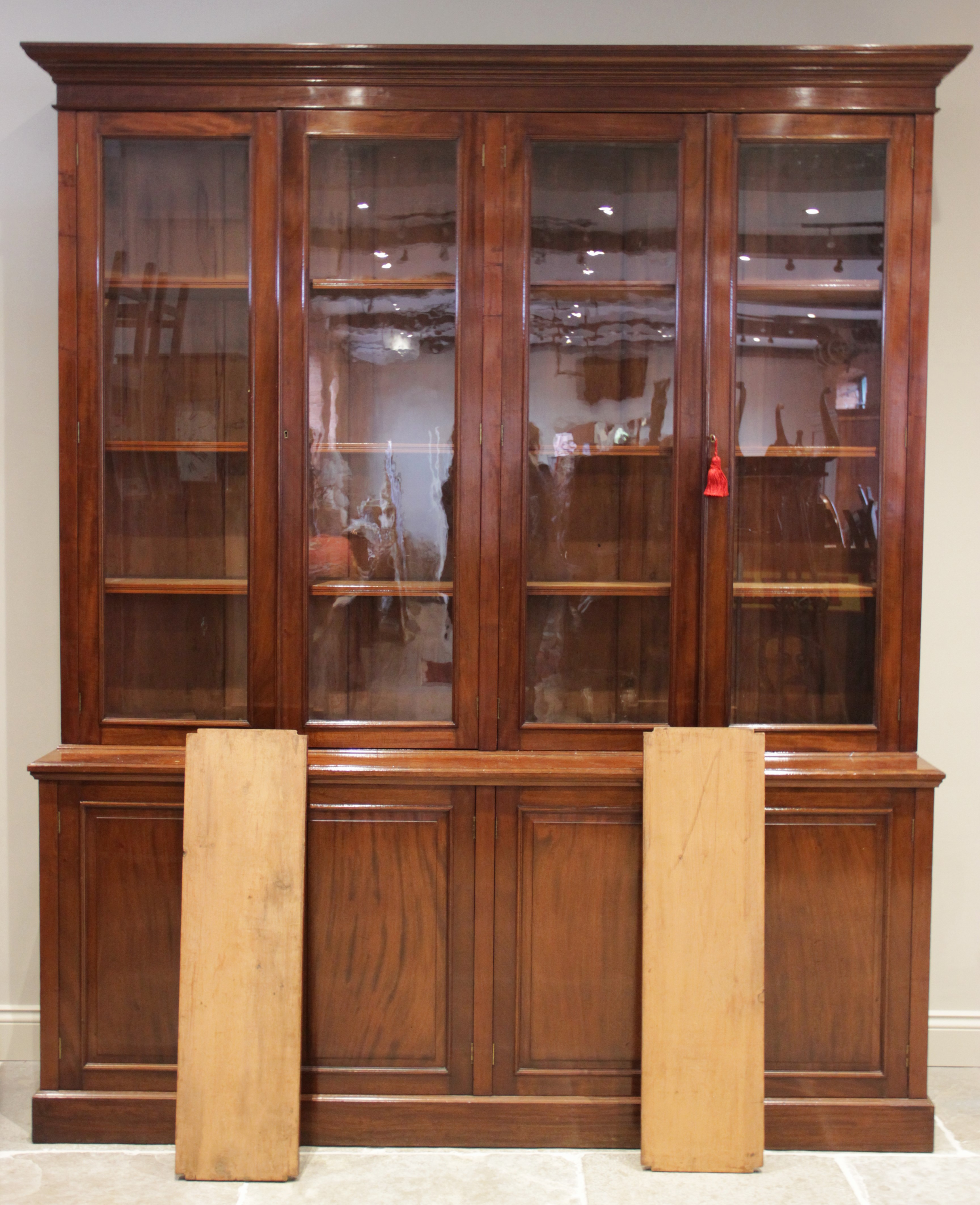 A mid 19th century mahogany library bookcase, the moulded cornice above a plain frieze and two pairs - Image 2 of 2