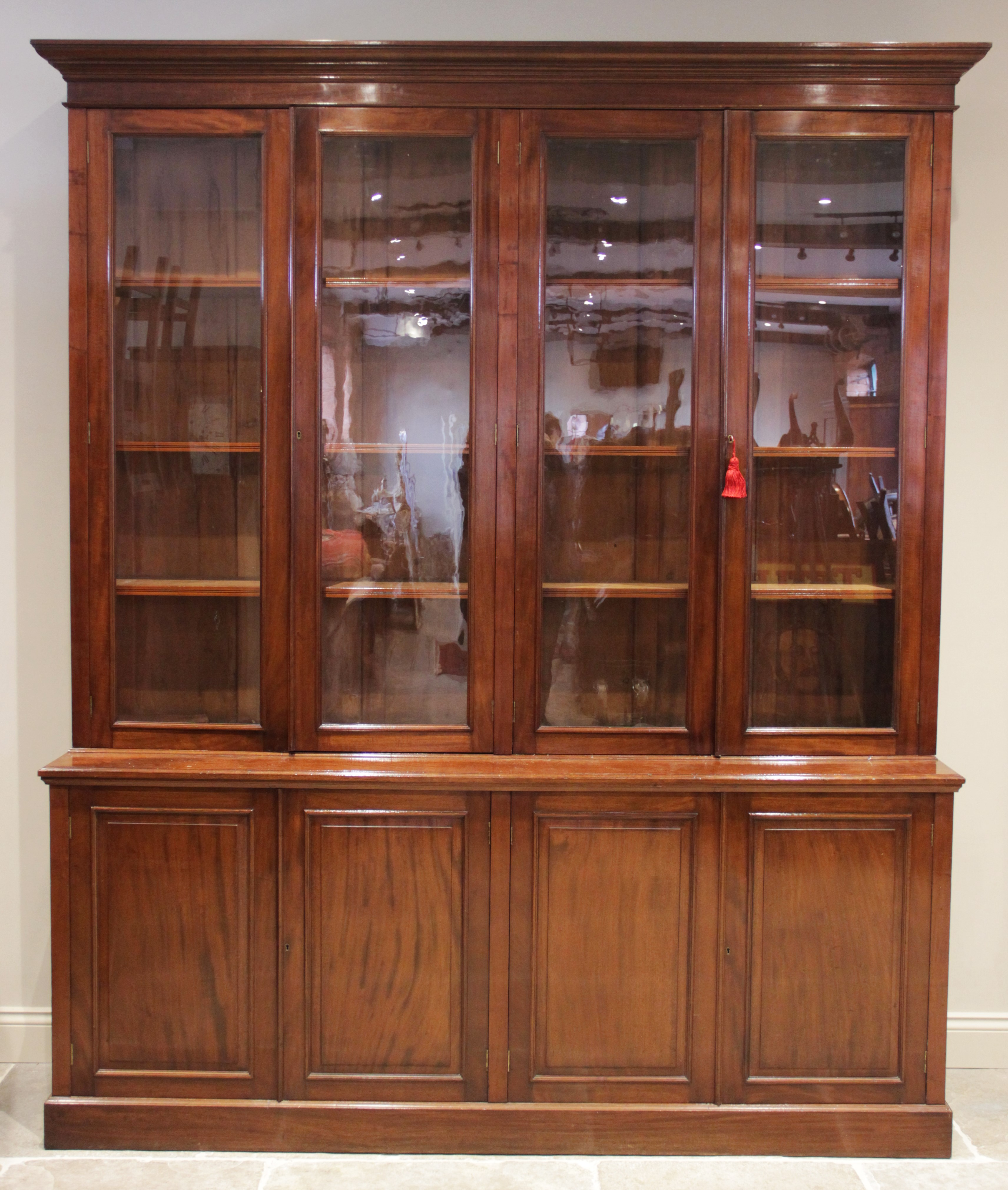 A mid 19th century mahogany library bookcase, the moulded cornice above a plain frieze and two pairs