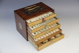 A Chinese Mahjong gaming compendium, enclosing five separate drawers each containing bone gaming