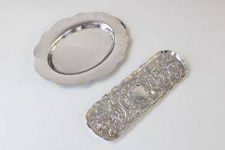 A silver card tray by Mappin & Webb, Birmingham 1977, of plain polished oval form with shaped