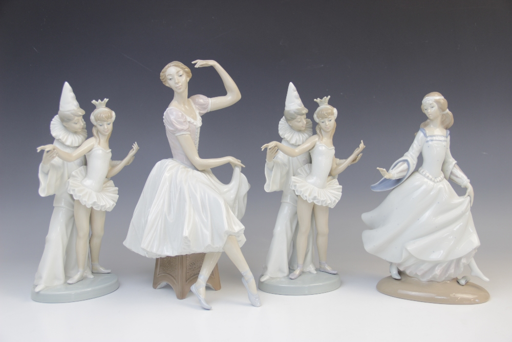 Four Lladro figurines, comprising: a seated dancer, 30cm high, two Pierrot and ballerina groups,