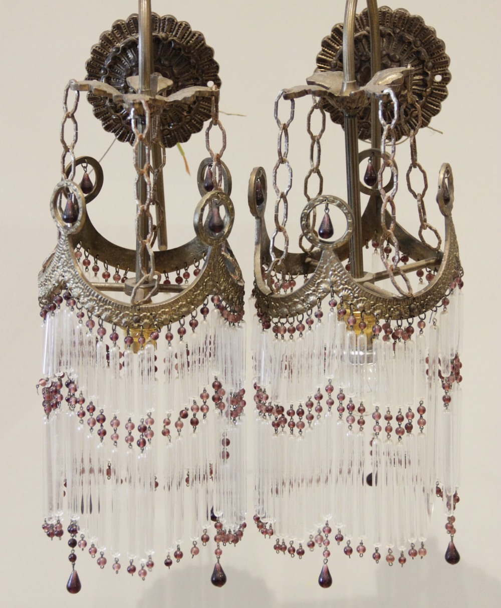 A pair of French gilt metal wall light fittings, early 20th century, each with a cast circular