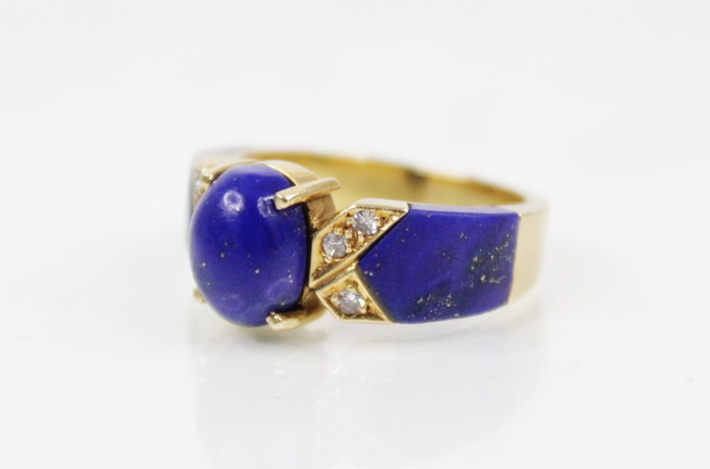 A lapis lazuli and diamond set dress ring, designed as a central polished oval lapis lazuli cabochon - Image 4 of 6