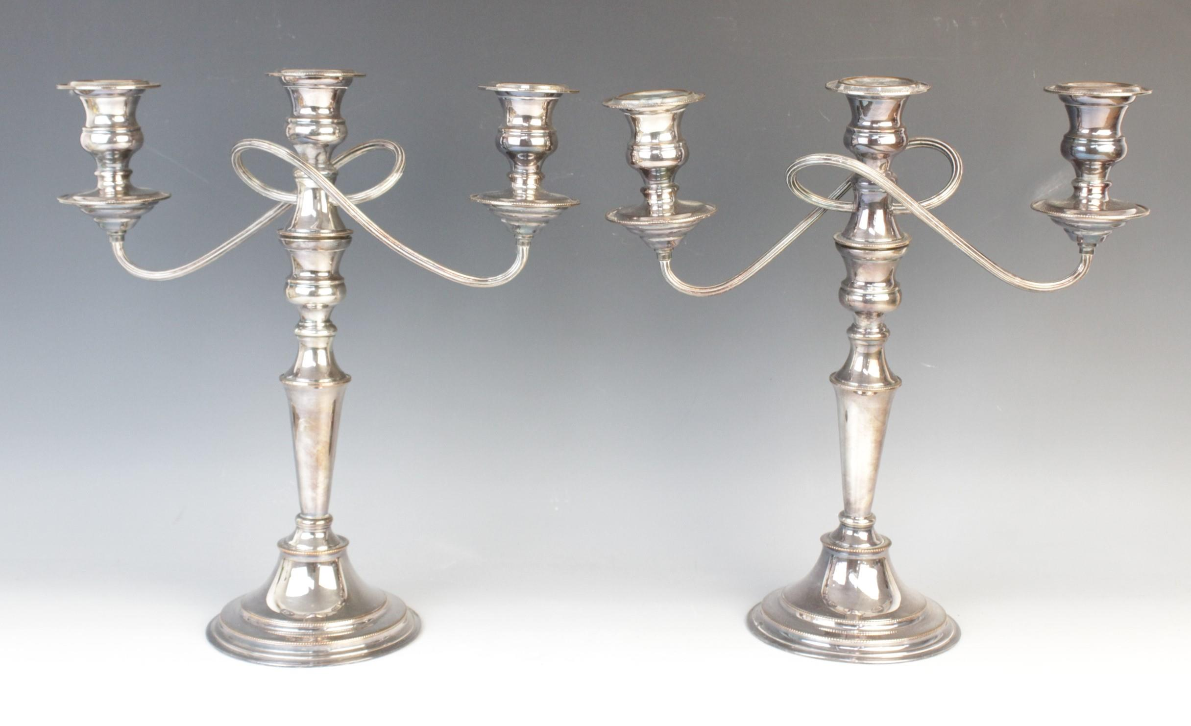 A pair of silver plated candelabras by Elkington & Co, each with tapering knopped columns on stepped - Image 2 of 3