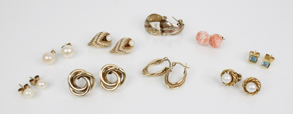 A selection of gold and gold coloured earrings, to include a pair of blue topaz gold coloured