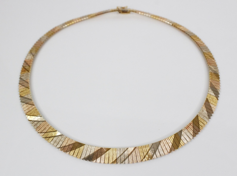 An 18ct three-colour gold collarette, comprising alternating sections of rose gold, yellow gold - Image 2 of 3