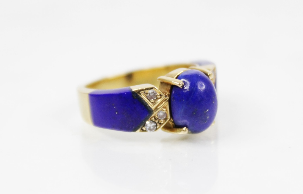 A lapis lazuli and diamond set dress ring, designed as a central polished oval lapis lazuli cabochon - Image 5 of 6