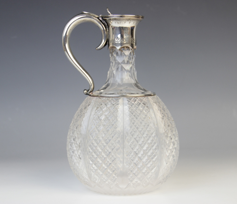 A Victorian cut glass silver mounted decanter by Horace Woodward & Co, London 1887, of compressed