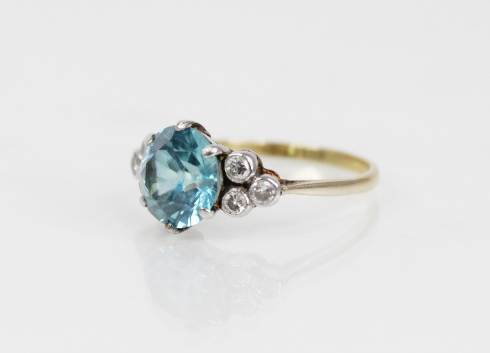 A zircon and diamond ring, the central round mixed cut blue zircon (measuring 8.65mm diameter), - Image 3 of 8