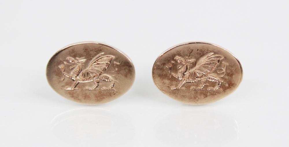 A pair of 9ct gold cufflinks, each designed as an oval panel engraved with a Welsh dragon, 20mm x