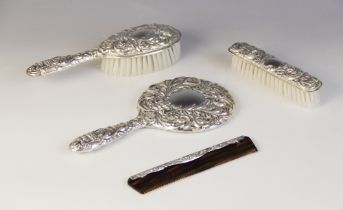 A four-piece silver backed dressing table set, W I Broadway & Co, Birmingham 1983, comprising hand