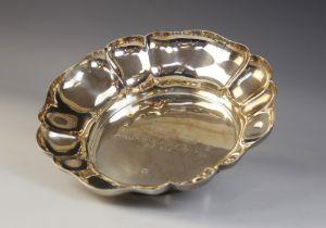 A silver lobed presentation bowl, Barker Ellis Silver Co, Birmingham 1968, of circular form with