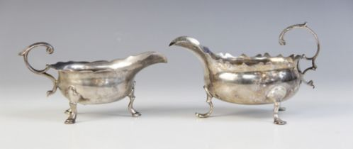 A George II silver sauce boat, London 1744 (maker?s marks worn), of typical form with scalloped