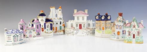 A collection of nine Staffordshire cottages, 19th century, to include two money boxes, a