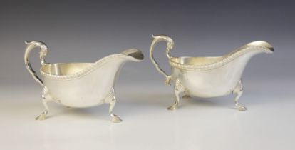 Two George V silver sauce boats, retailed by Lowes, Chester 1934, one marked for Stokes & Ireland