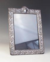 A silver mounted Art Nouveau style photograph frame, John Bull Ltd, London 1990, of rectangular form