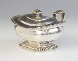 A George III silver wet mustard pot, London 1813 (maker's mark worn), of squat form on raised reeded
