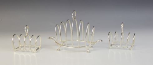A Victorian silver six-division toast rack, Henry Wilkinson & Co, London 1893, the shaped base