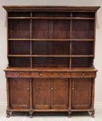 A mid 19th century elm dresser, possibly French, the high back with a moulded cornice over three