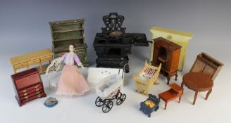 A selection of vintage dolls house furniture and accessories, to include; a cast iron range