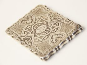 A Victorian silver card case by George Unite, Birmingham 1872, of shaped rectangular form, chased