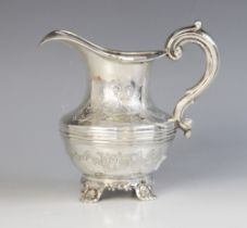A Victorian silver milk jug, Richard Pearce & George Burrows, London 1843, of baluster form on