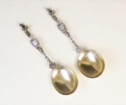 A pair of Edwardian silver Dutch-style spoons by Holland, Aldwinckle & Slater, London 1906-7, each