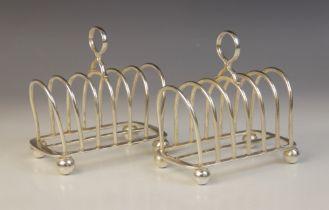 A pair of Edwardian silver six-division toast racks, Goldsmiths & Silversmiths Company, London