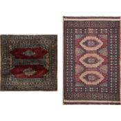 DUE TAPPETI KASHMIR trama ed ordito in cotone, vello in lana (usura vello). Pakistan XX secolo -