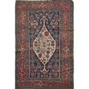 TAPPETO BAKTIARY trama ed ordito in cotone, vello in lana (usure). Persia prima metà XX secolo - cm