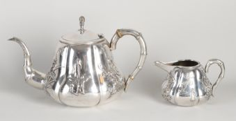 Chinese silver teapot and pitcher