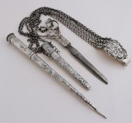Silver chatelaine with scissors and tubes