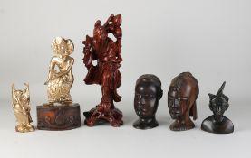 Six Oriental wooden statues