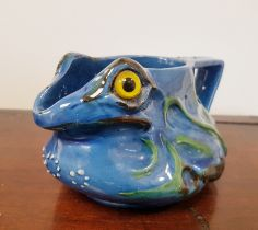 C H Brannam Pottery Grotesque Frog circa 1900 with yellow glass eyes and makers marks to base.