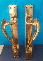 A pair of large brass Art Nouveau Door Handles