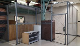 APPROX. 53' LINEAR FT OF SECURITY ENCLOSURE FENCING, WHICH INCLUDES (2) 4' WIDE DOORS, 10' HT, NO