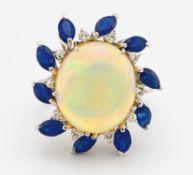 OPAL-SAPHIR-RING. 750/- Weißgold, Punze, Gesamtgewicht: ca. 10,5 g. EU-RM: 55. 10 kleine Diamanten Ø