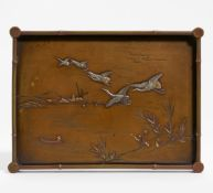 TRAY WITH CRANES, FLYING UP FROM A LAKESIDE. Japan. Meiji period (1868-1912). Bronze (sentoku)
