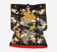 UCHIKAKE. Japan. Early 20th c. Black satin silk, heavily embroidered with colored silk and gold.
