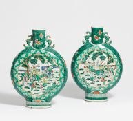 A PAIR OF MOON FLASKS WITH SCHOLARS. China. Before 1900. Heavy porcelain painted in famille verte.