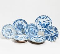 TEN DISHES WITH BLOWERS AND LANDSCAPE. China. Qing dynasty. 18th c. Porcelain in underglaze blue and