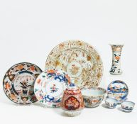 TOKKURI, VASE, TWO DISHES, BOWL AND A PAIR OF CUPS WITH SAUCERS. Japan. Edo period. Arita porcelain,