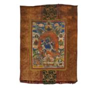 THANGKA WITH MAHAKALA. Tibet/Nepal. 19th-20th c. Pigments on fabric. Mounted with printed